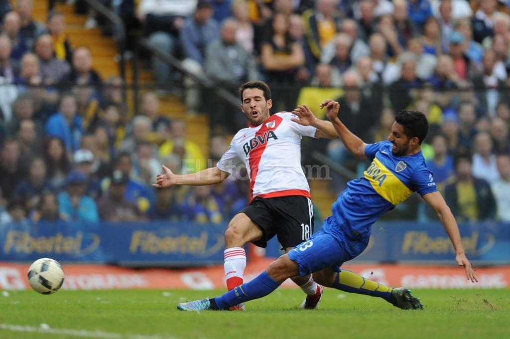 Boca Juniors y River Plate, ajenos a la lucha por el Campeonato de la Primera División, empataron sin goles hoy en un superclásico intenso y con poco juego, pero con emociones hasta el final Crédito: Agencia Télam