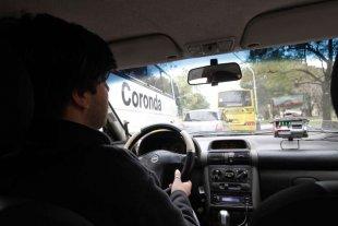 Estudian conectar el bot�n de p�nico de los taxis al 911
