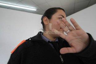 Mujer polic�a herida al  sufrir un violento asalto