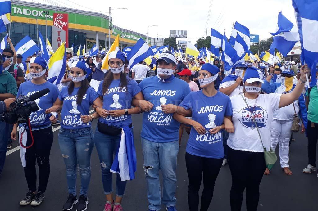 Opositores al Gobierno durante una marcha en respaldo a los obispos y en demanda de más justicia y democracia el 28/07/2018 en Managua, Nicaragua.  Crédito: dpa