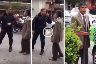 Ascendieron a los dos policías que no se dejaron amedrentar por un juez - Uno de los policías y el juez durante el fuerte cruce que mantuvieron en la calle durante un operativo.