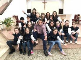 Festival Navideño de Coros de la Universidad Católica - Miguel Piva, director de los coros de la UCSF, junto con la formación 2018 del Coro de Niños. -