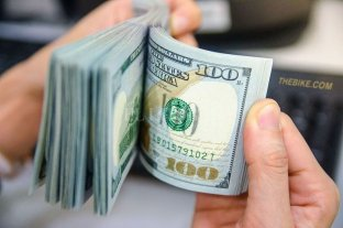Leve caída del dólar, que cerró a $ 57,27