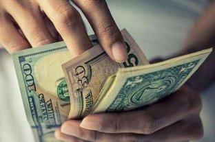 El dólar bajó a $ 62,91 -  -