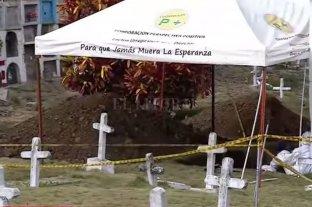 """Exhuman siete cuerpos más de posibles víctimas de """"falsos positivos"""" en Colombia"""