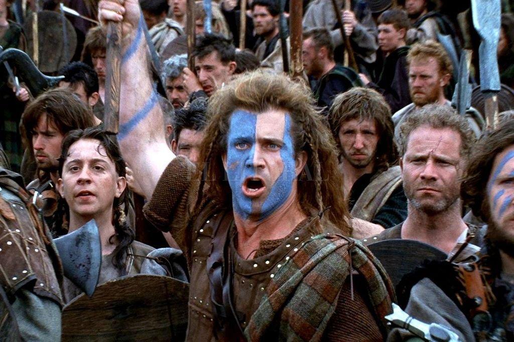 Caracterizado como rebelde escocés del siglo XIV, Mel Gibson hizo uno de sus papeles más conocidos.  Crédito: Paramount Pictures / Icon Productions / Ladd Company
