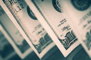 """El dólar oficial abre a $ 76,50 y el """"blue"""" mantiene la baja y se vende a $ 128 -  -"""