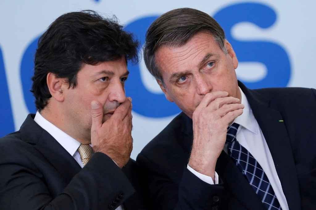 Luiz Mandetta y Jair Bolsonaro en otros tiempos, cuando el primero de ellos estaba a cargo de la cartera de Salud de Brasil. La pandemia los terminó por enemistar. Crédito: Archivo
