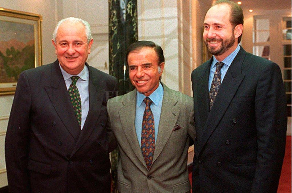 El ex presidente junto a los entonces intendentes Héctor Cavallero (Rosario) y Omar Perotti (Rafaela) Crédito: Archivo El Litoral