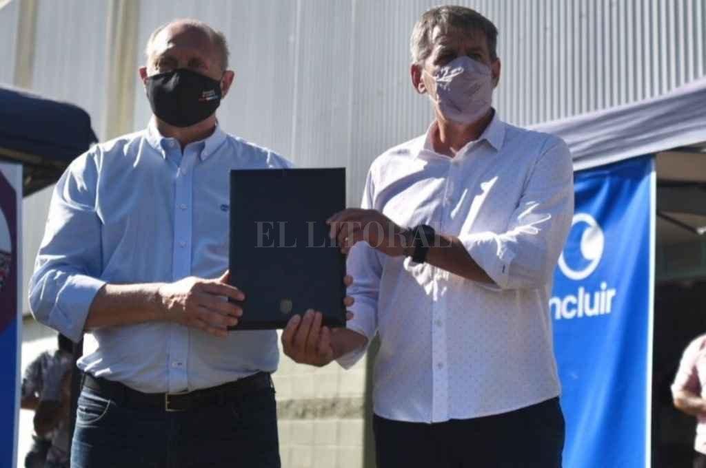 Jatón y Perotti en la firma del convenio. Crédito: Gentileza