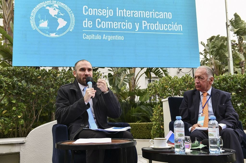 Martpin Guzmán y Daniel Funes de Rioja, titular de la UIA. Crédito: NA